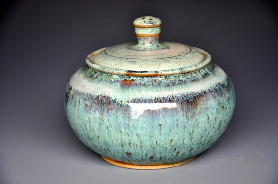 Small pottery jar with lid