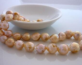 Pretty creamy peach baroque chinese kasumi pearls 10-13mm 1/2 strand.