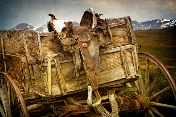 Old Western Horse Saddle and Wagon with Montana Mountains in the Background No.2336 - A Western Landscape Photograph
