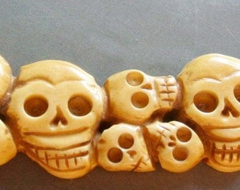 Ox Bone Carved Thirteen Skulls Pendant 105mm x 33mm  T1340