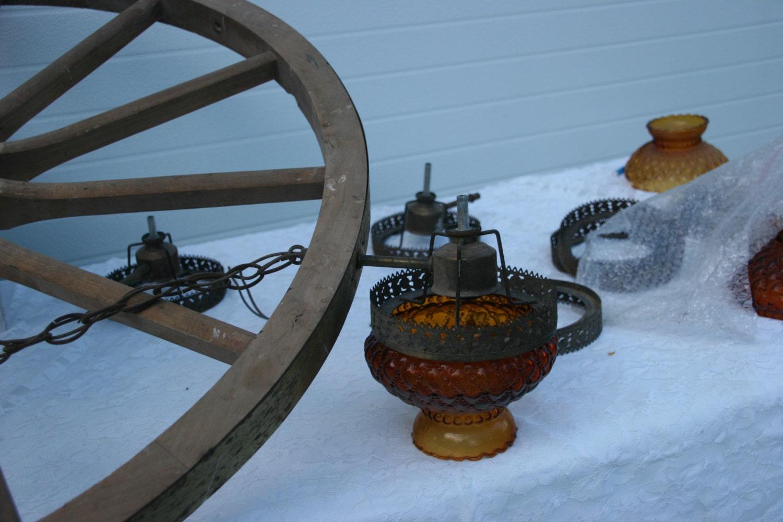 Antique wagon wheel chandelier large wagon wheel chandelier at antique wagon wheel chandelier wooden wagon wheel chandelier color by idolizedvintage arubaitofo Image collections
