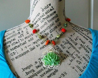 Mint green Lotus Pendant Necklace on white filagree backing Orange and green beads, and Long Chain
