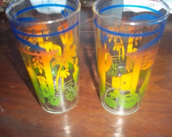 Vintage drinking glass with bright design of the SW of cactus palm trees, pottery, patio