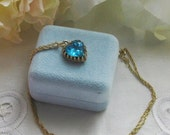 25% OFF SALE Repurposed necklace Gorgeous blue rhinestone heart with goldtone setting