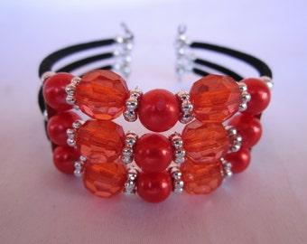 Orange color adjustable acrylic beaded three loop style fashion bracelet
