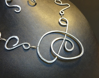 Stunning hand made, wire worked abstract necklace set.made of galvanized steel.