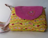Embroider quilt purse in yellow with hearts, ladybug, flower and swirls