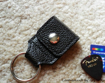 100% hand stitched super dark brown cowhide leather keychain / SD card / guitar pick / golf ball marker holder with a Fender Celluloid pick