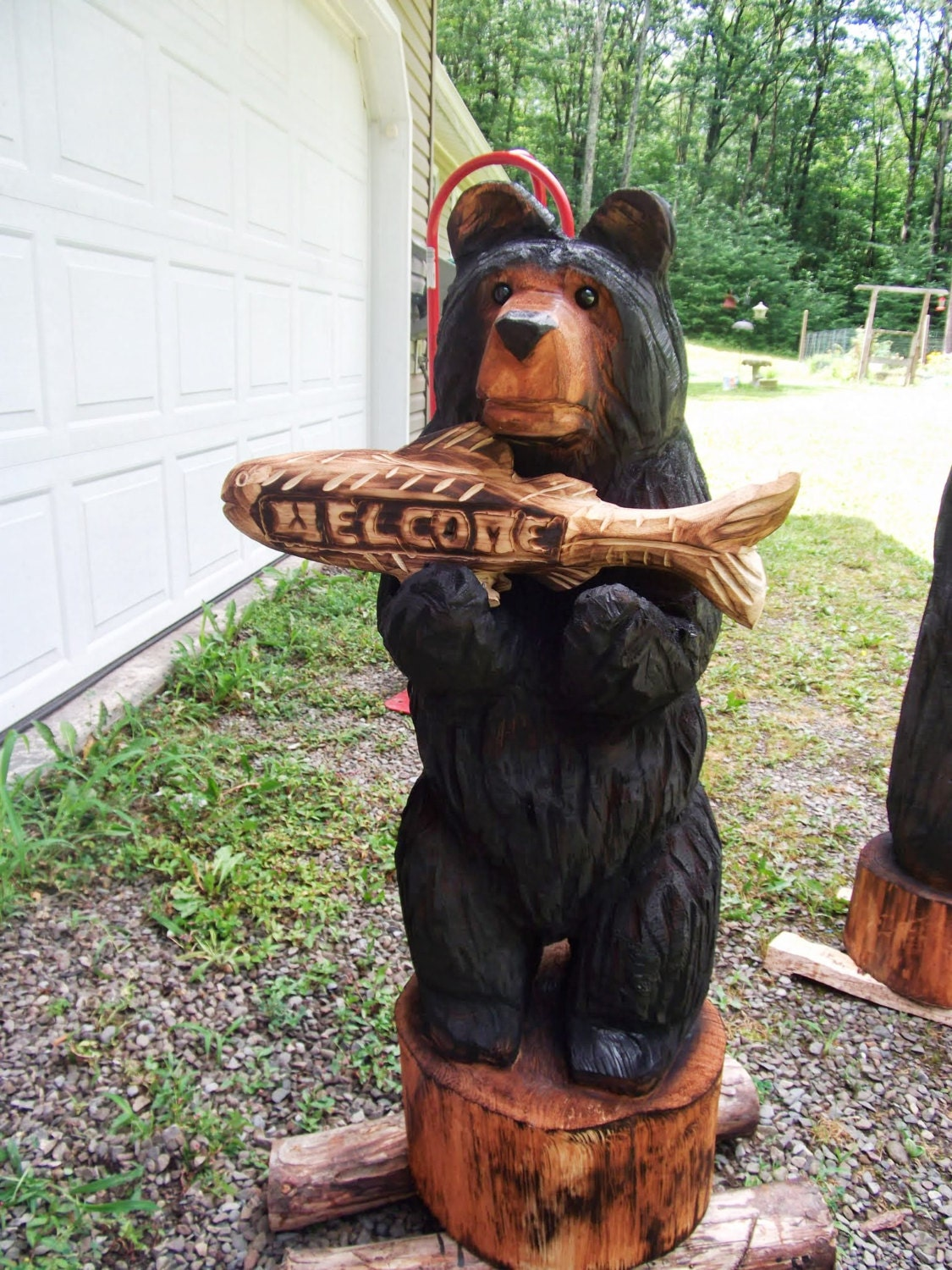 Chainsaw carved black bear with fish