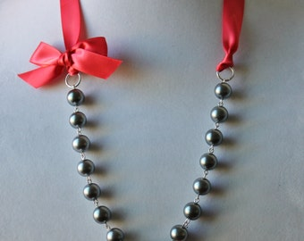 Charcoal Gray Pearl and Guava Ribbon Bow Necklace