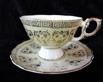 Beautiful Vintage Pedestal Cup and Saucer
