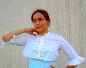 Vintage white bolero with flowers