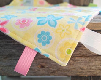 Bright yellow, pink and blue flowery snuggle tag blanket