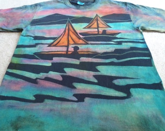 Sail boats, sunsets, palm trees, man's large discharge t-shirt with procion dyes added, turquoise, orange,greens, yellow red, and pink