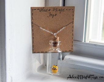Tiny Pikachu in a Bottle Necklace