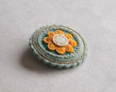 Round felt brooch with orange flower, hand embroidered brooch