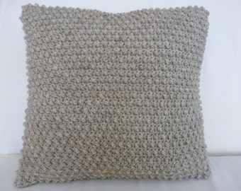 Textured oatmeal colored crocheted 18' square pillow cover with button closure