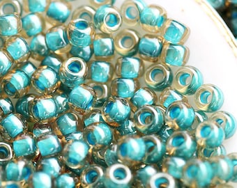 Toho Seed beads, size 11/0, Turquoise Lined - Inside color Jonguil, N 953, rocailles, glass beads - 10g - S096