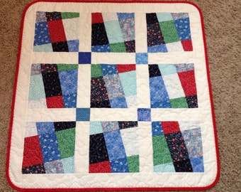 "The Wonky Nine-Patch Comes To Life In Scrappy Fashion In This 29"" X 29"" Quilt For Baby"