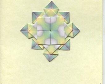 Greetings card with teabag folded medallion design