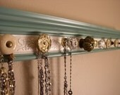 """jewelry holder in vintage jade color. This necklace hanger has a  total of 9 decorative knobs w/ embossed champagne background 26 """" wall"""