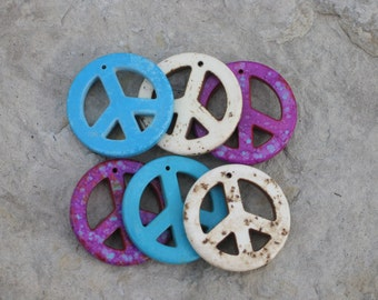 Peace pendants three for a dollar