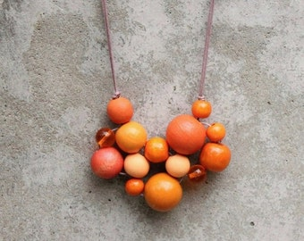 Orange bib necklace, bubble, bead necklace,statement, contemporary, tangerine, funky, woven bead necklace, fashion.