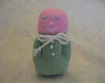 Hand knit baby doll.