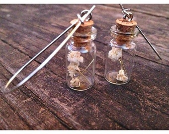 handcrafted miniature glass vial and baby's breath, silver hoop dangle earrings.