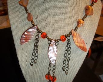 orange and antique bronze necklace