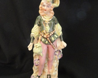 Coventry figurine is numberd, pink and green, ceramic