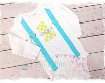 2 Pc. BOYS FIRST BIRTHDAY Outfit-Boys Birthday bodysuit with Gray Chevron 1, aqua suspenders with aqua and white chevron crawlers and Beanie
