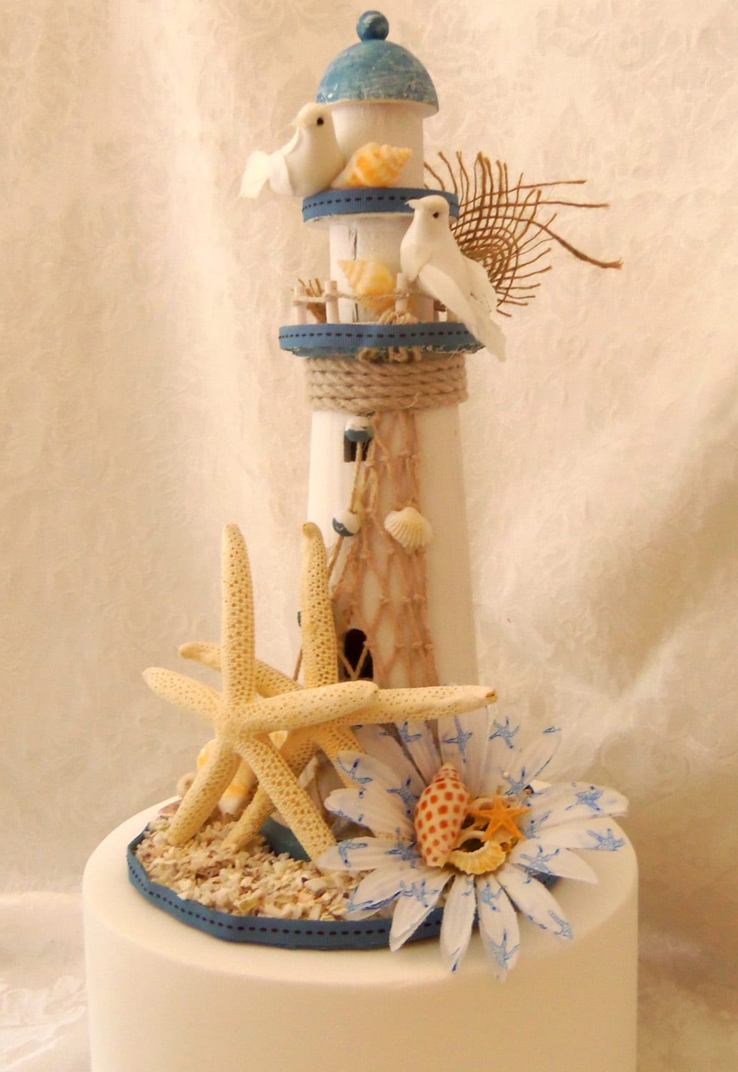 nautical cake toppers for wedding cakes nautical lighthouse starfish cake topper up cycled cake 17728