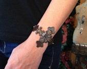 Iron Cross Metal Cuff Bracelet with Fleur de Lis embellishment
