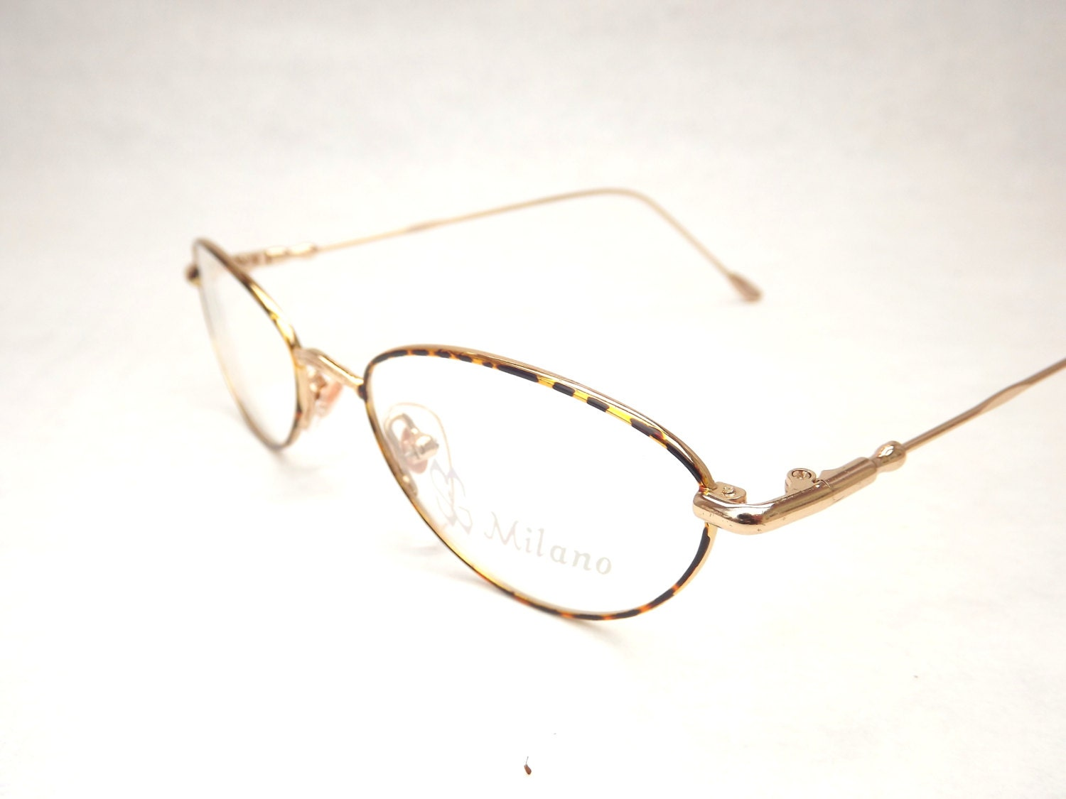oval womens eyeglasses tortoise shell and gold metal vintage