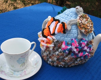 Under the tea coral reef tea cosy. Made to order, your choice of undersea creatures decorating it.