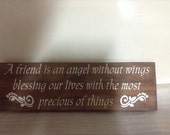 24x6 A friend is an angel without wings   Smooth Finish with Dark Stained Board White Lettering Wooden Sign