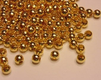 40 gold plated spacer beads, 5 mm (K10)