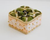 Tufted Moss and Burlap Ring Bearer Pillow with Peach Ribbon and Lace.