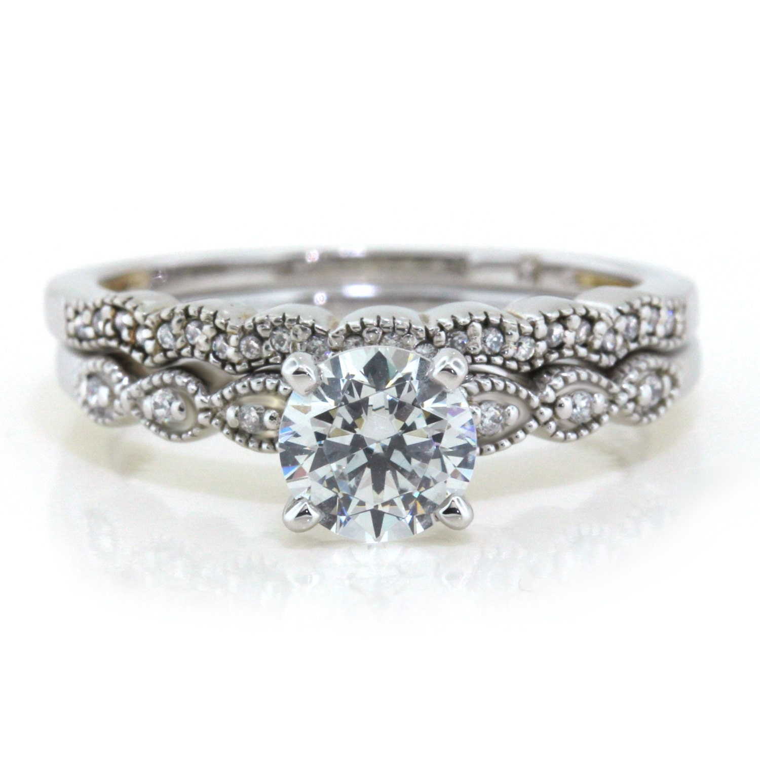 dainty moissanite engagement ring wedding band