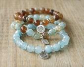Beaded Bracelets - Set of 3 Yoga Inspired Beaded Stretch Bracelets - Thai Silver Om Charm, Lotus Charm and Inspirational Word Charm