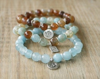 Beaded Bracelets - Set of 3 Yoga Inspired Beaded Stretch Bracelets - Thai Silver Om Charm, Lotus Charm and Inspirational Word Charm