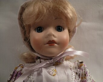 Vintage Home Spun Porcelain Doll
