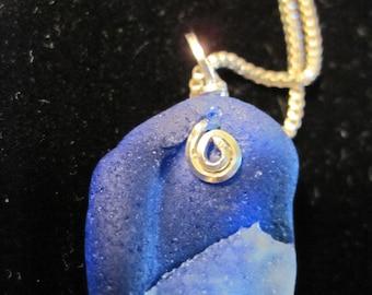 Awesome bon fire blue sea glass necklace.