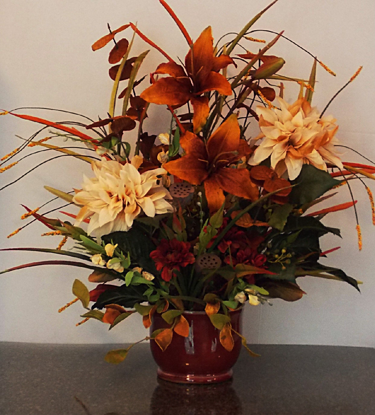 Fall silk floral arrangement with copper day lillies sofa