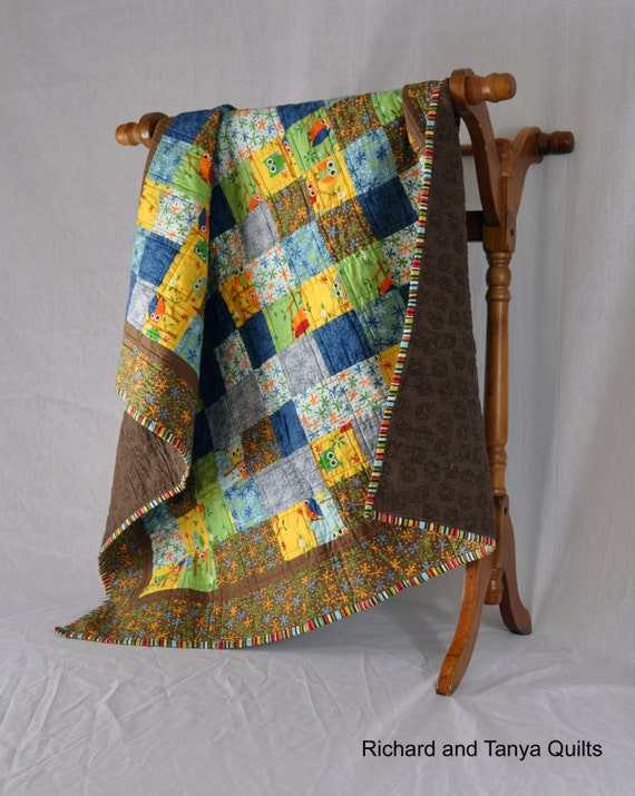 Owl Patchwork Quilt in browns, greens, blues grays, and yellows 39 by 42 inches
