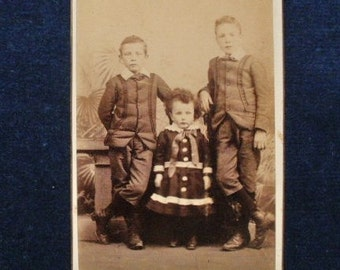 Carte-de-visite, antique, of two brothers & a sister, wearing their best clothes.  Blank reverse. c1875.