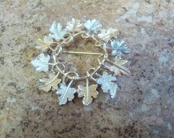 Beautiful and vintage fall wreath Sarah Coventry brooch in gold and silver tone metal