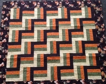 Fall colored rail fence lap quilt