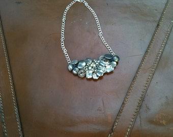 Silver button bib necklace